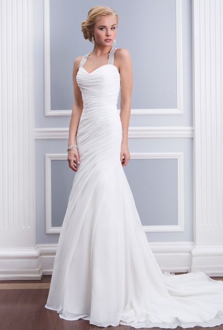 Brides: Lillian West. Chiffon fit and flare features asymmetrical pleating and a beaded halter neckline with a criss-cross keyhole back. Gown has chapel length train and chiffon buttons cover the zipper.