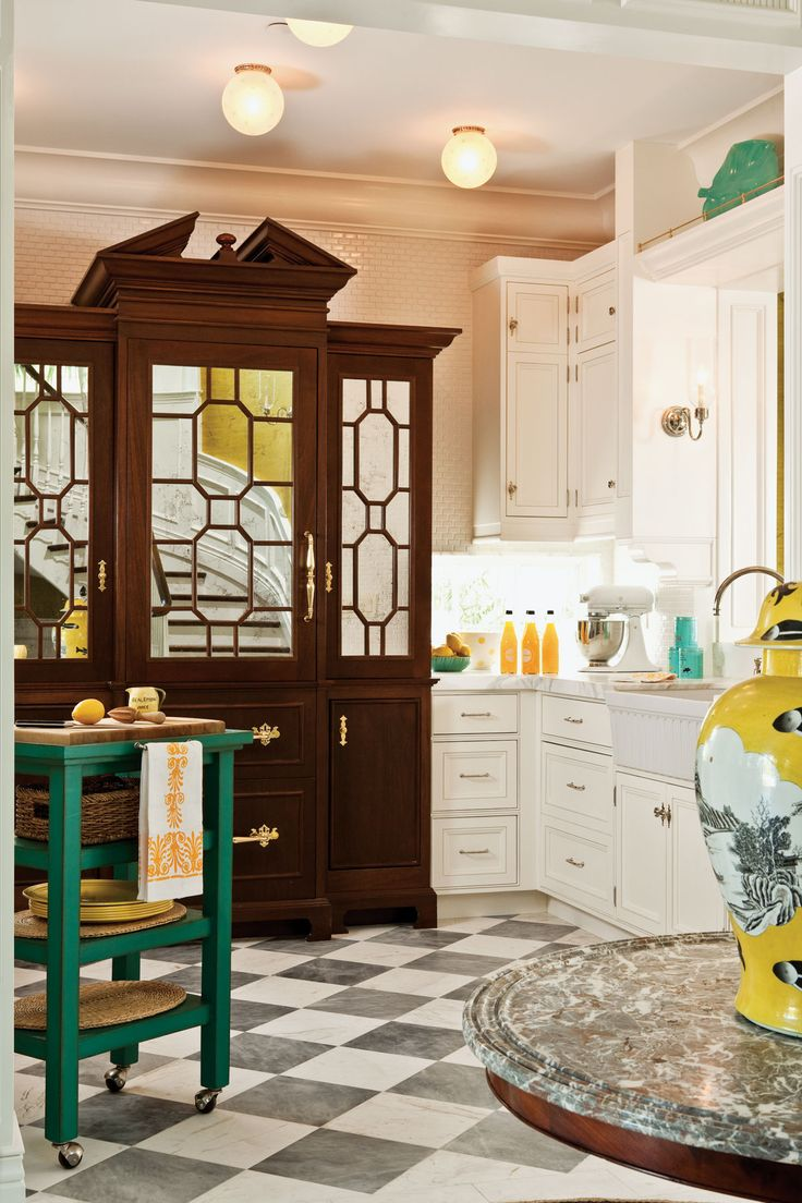 Because the reorganized floor plan places the kitchen in direct view upon descending the new stairway, designer Phyllis Taylor felt the need to create an extraordinary piece of furniture — a mahogany armoire that houses a refrigerator and pantry.