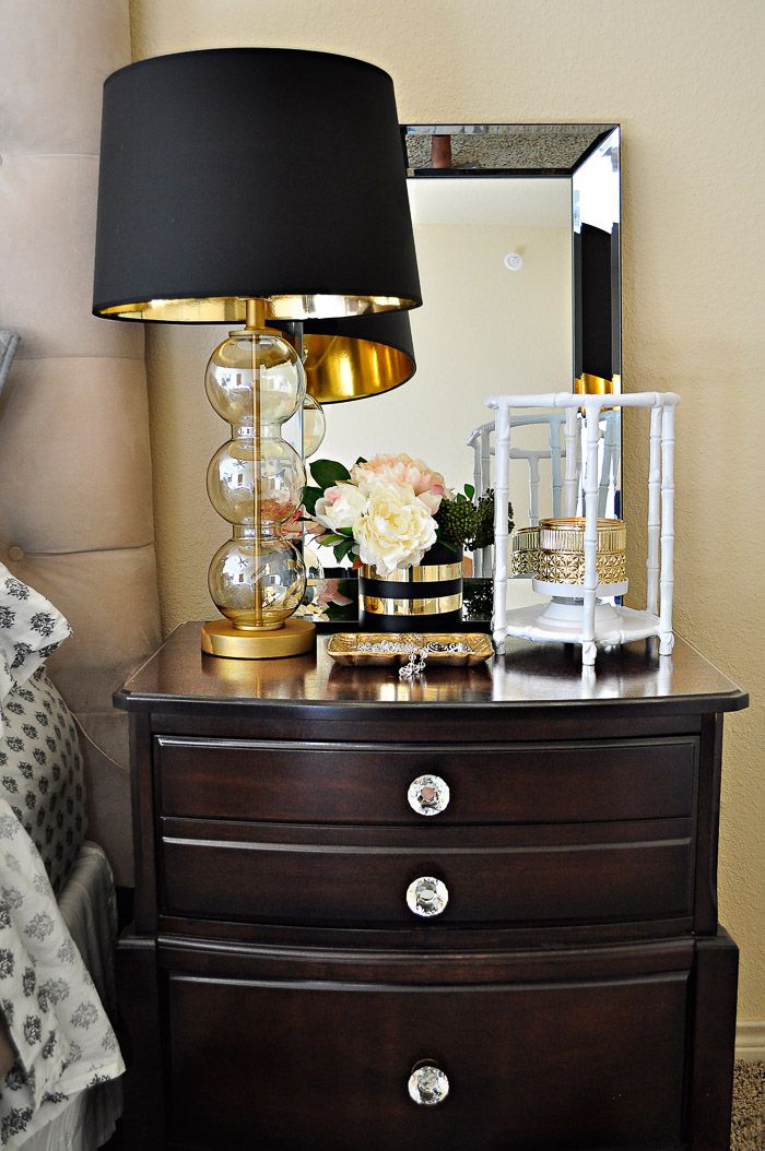 Decor ideas for making a master bedroom in an apartment or rental more glam using black, white and gold accents. | via monicawantsit.com #ad