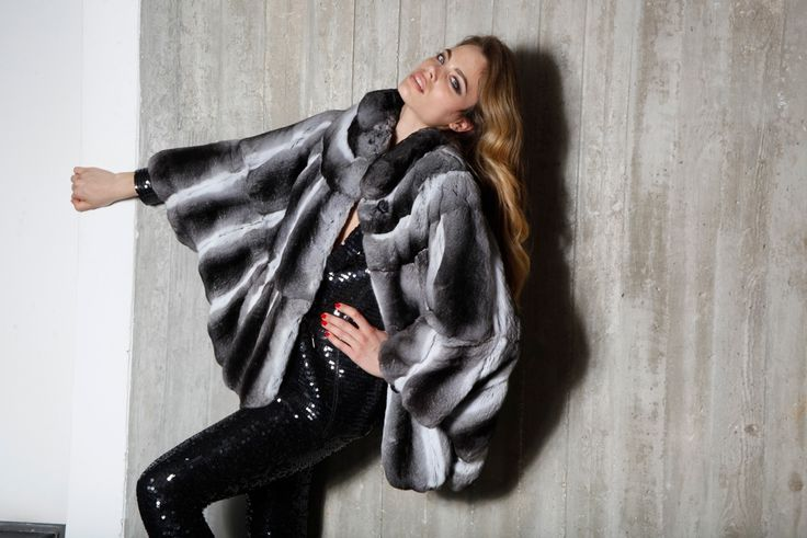 Take your personal style to the next level. This black and white chinchilla fur jacket is all you need.
