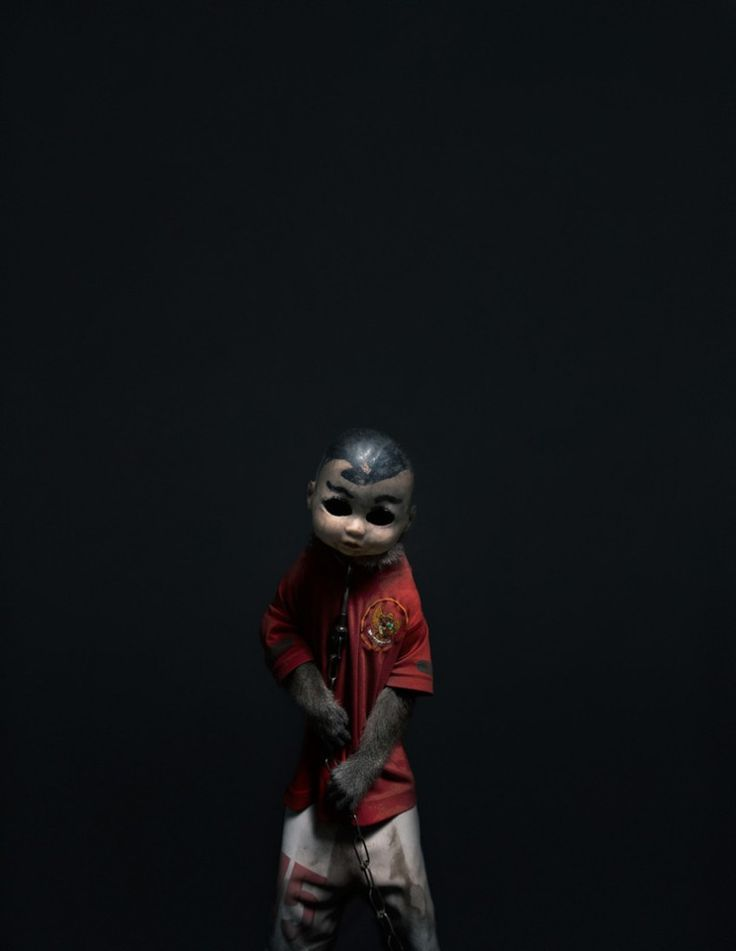 """Perttu-Saksa """"A Kind of You"""" series featuring trained performance monkeys in Indonesia wearing creepy doll masks"""