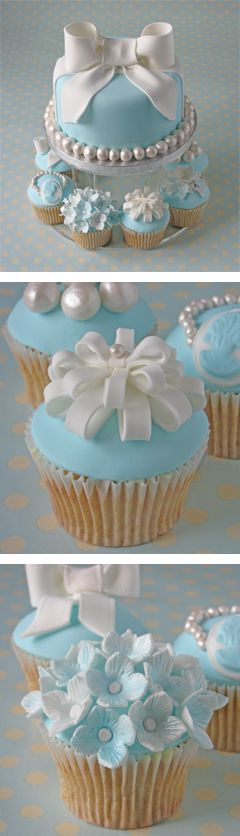 "This is a beautifully decorated blue cake and cupcakes - perfect or a baby boy shower or Christening - or an engagement party as it's ""Tiffany Blue"""