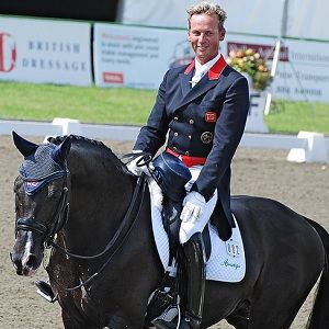 Team gold for Britain's only openly gay Olympian Carl Hester