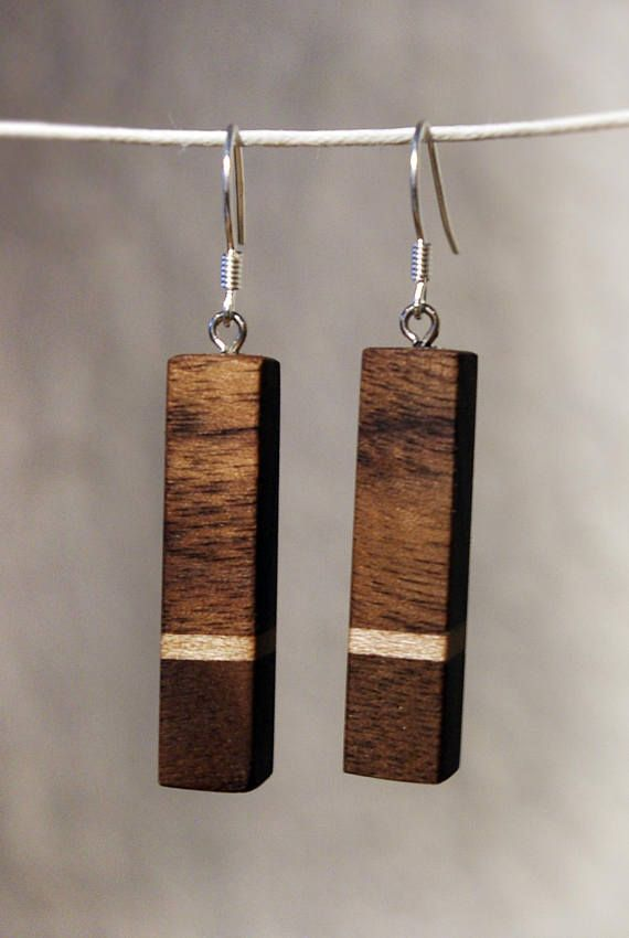 These are beautiful walnut and maple handmade wooden earrings.   modern. Super classy. See more photos and other designs at my shop. Just click on the photo!