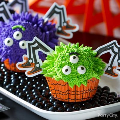 Spooky-cute spider cupcakes with silly faces!