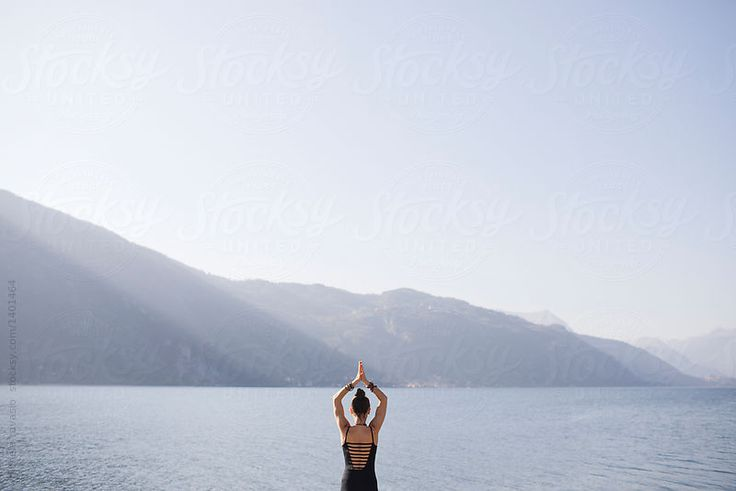 Doing yoga in a beautiful natural scenery by michela ravasio for Stocksy United