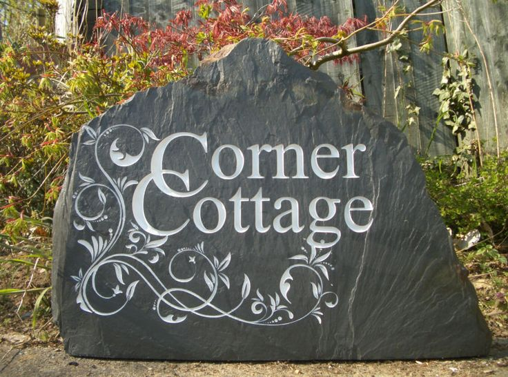 Customer's own design house sign on a big slab of Welsh slate. http://www.rusticstone.net/sold-free-standing-slate-house-signs/