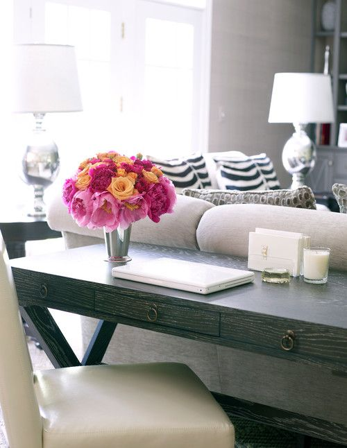 Ideas for using a writing desk as a sofa table to maximize space and function while maintaining a decorative look.