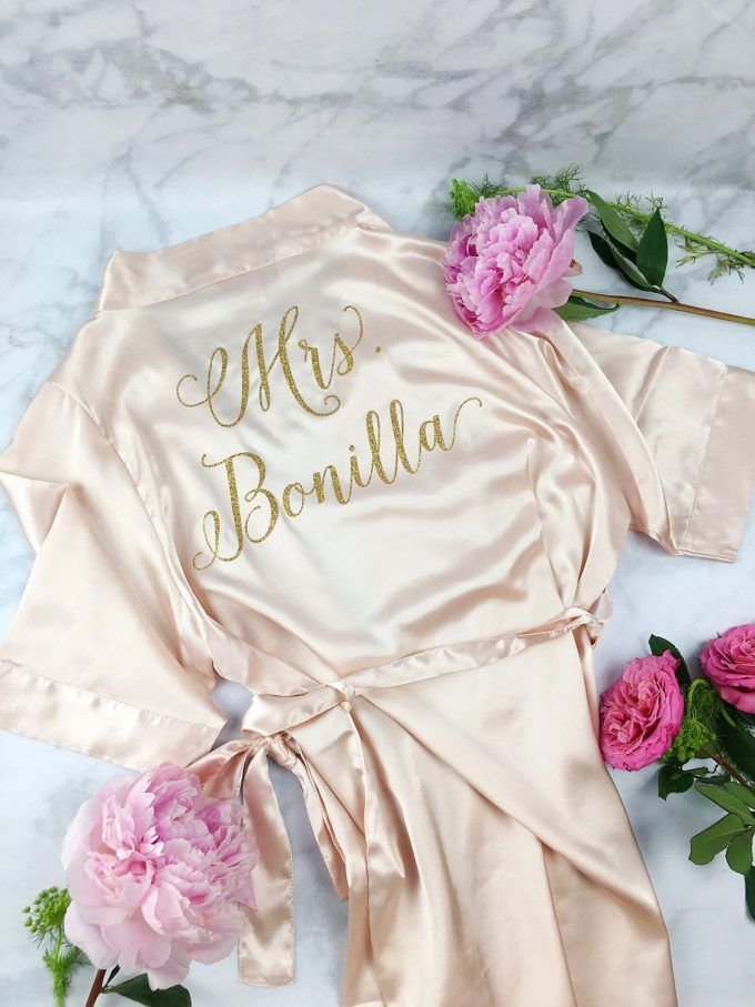 This is a really cute bride robe for getting ready! Love the personalization on the back with your new last name.