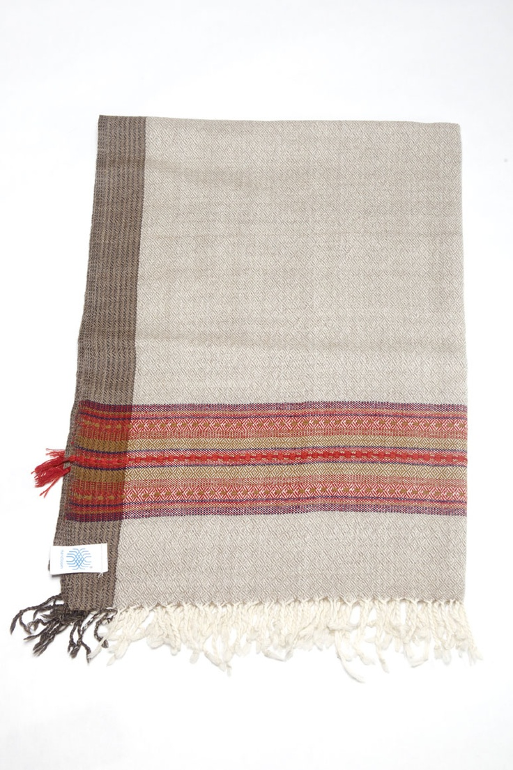 Jalori -This stole comes in a neutral but elegant sand color, accented with a dark taupe side border and autumn red trim. A subtle diamond pattern can be seen in the weave. Simple yet stunning. Approx. 193cm x 67cm. $60.00