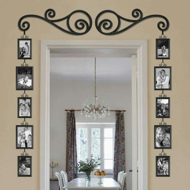 Great doorway entrance. Hanging pictures like this is great in ...