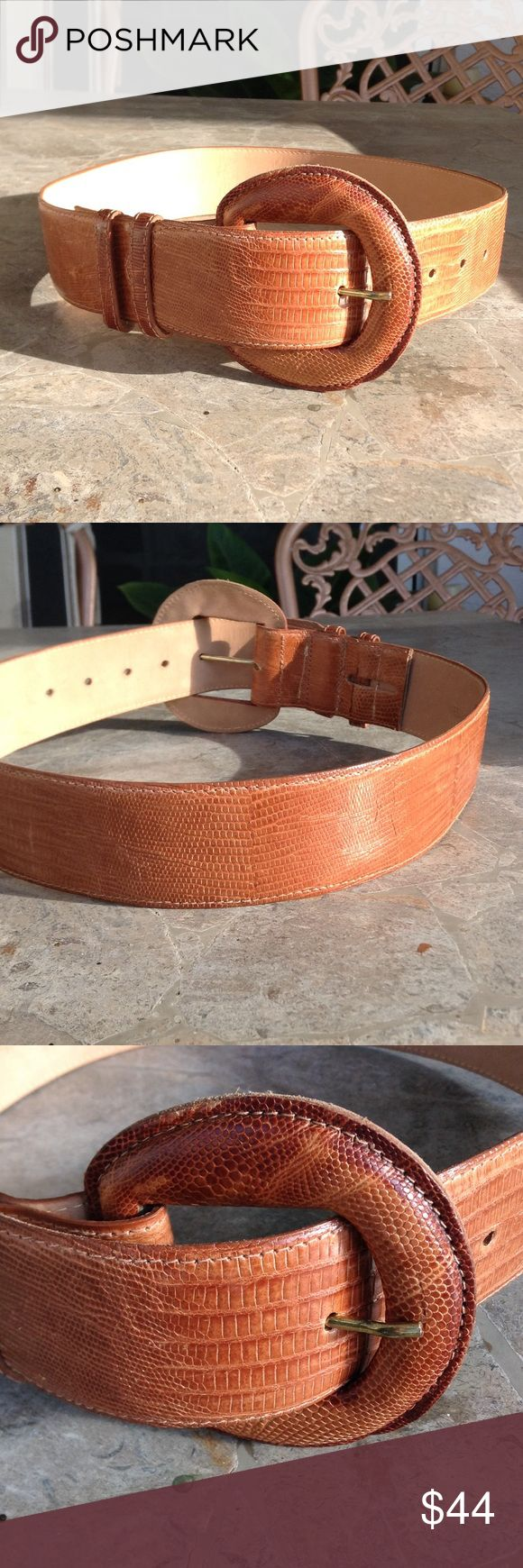Genuine Lizard Wide Cipriani Belt Absolutely beautiful genuine lizard brown belt by Cipriani, has large lizard buckle, belt is a little over 2 inches wide, and will fit a 25 to 29 inch waist, worn once, pristine condition. Cipriani Accessories Belts