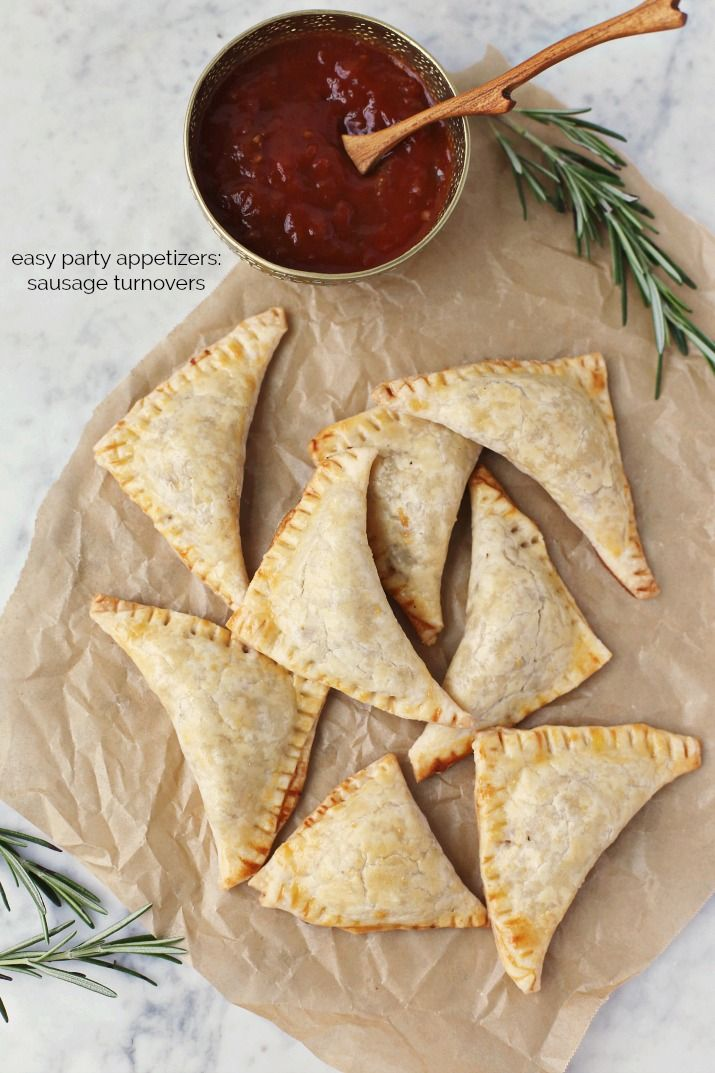 Make this Sausage Empanadas recipe the next time you want a hearty party appetizer to serve. These tasty packets are like hand-held comfort food that can be served for cocktail hour or for brunch. You can even make them ahead and freeze! Get the recipe here. #partyfood #appetizers #empanadas #sausage #partyappetizers