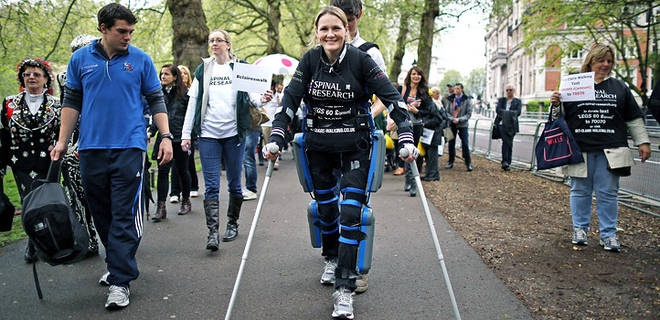 Paralyzed woman walks with bionic suit.