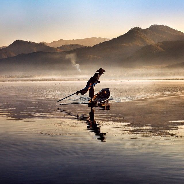 thephotosociety Photo by @stevemccurryofficial (Steve McCurry)  An Intha fisherman goes out at dawn on Inle Lake, Cambodia.
