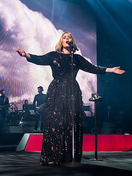 Adele's arms are wide open on Monday in Belfast, Ireland, where she began her world tour Adele Live 2016 (and even helped a couple get engaged!).