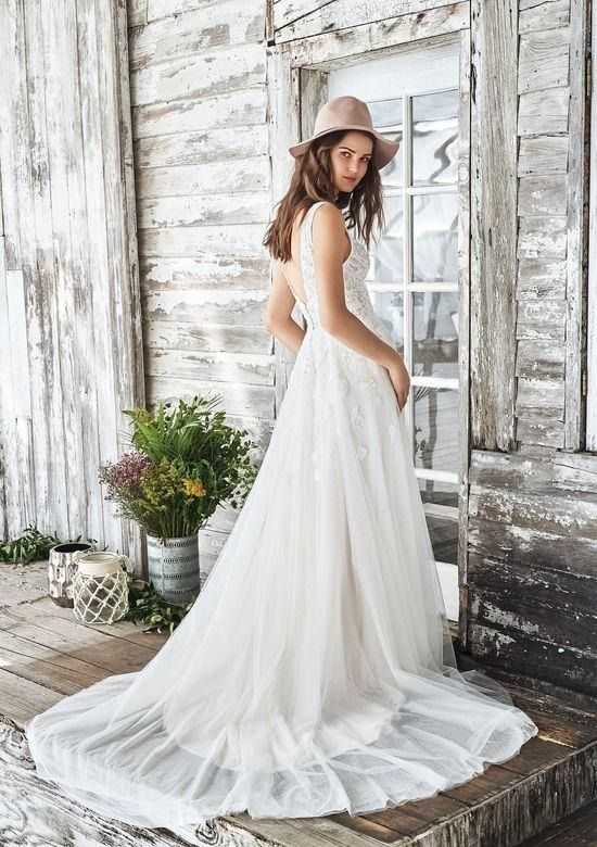 82ea8a511f Undeniably a charmer. This natural waist A-line gown featuring an illusion  lace bodice
