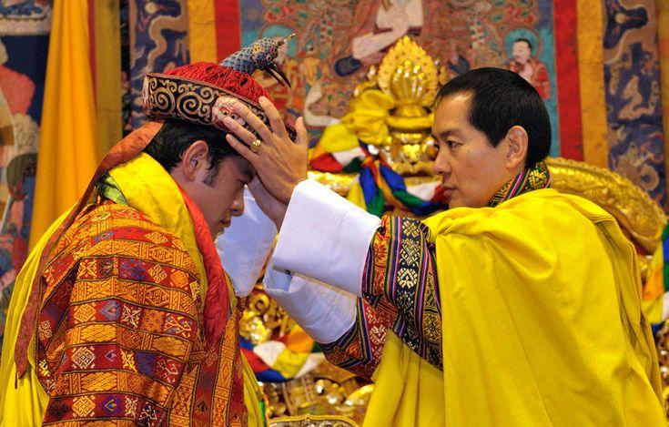 Bhutan's fourth King Jigme Singye Wangchuck (right) crowns his son Jigme Khesar Namgyel Wangchuck as the fifth King of Bhutan.