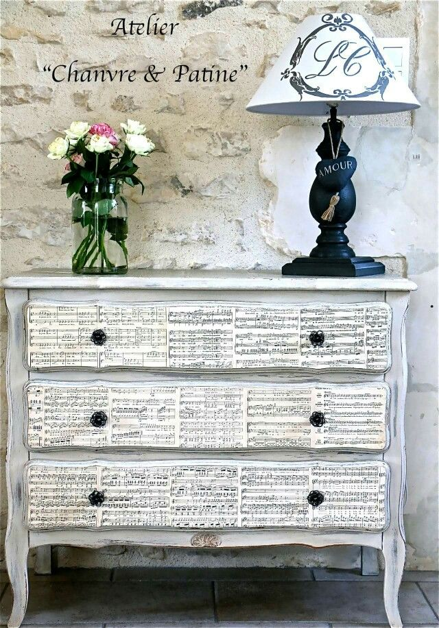 Painted dresser with faux fronts in music paper
