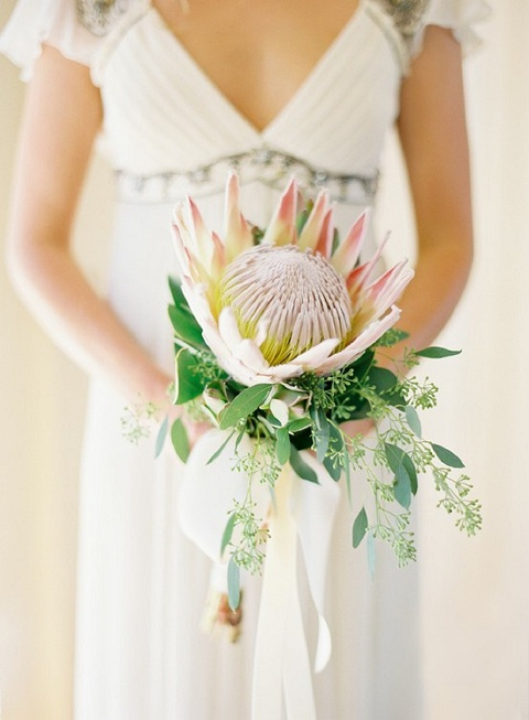 it's all in the details: 10 favourite bouquets | bloved weddings | UK Wedding Blog | Wedding Inspiration & Styling gorgeous protea single bloom bouquet Amy beach wedding bohemian gypsy