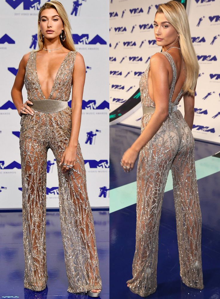Hailey Baldwin wore a silver jumpsuit in a super thin material with a low V-neck and wide velvet belt to the VMAs in 2017.