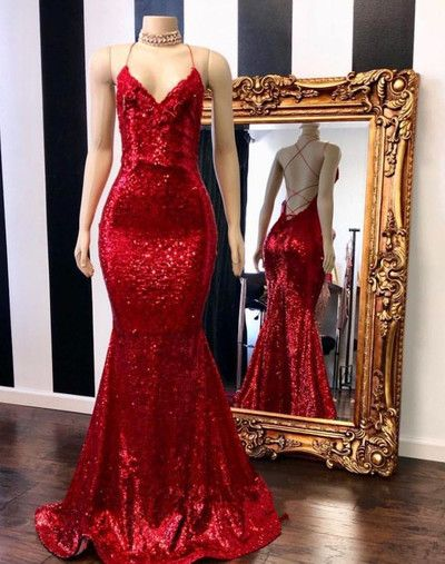 52461e33484 Timeless red sequin trumpet floor length prom gown. V neckline with  spaghetti straps open back.