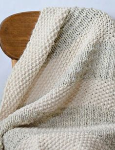 Free Knitting Pattern for Easy Heirloom Blanket - This beginner friendly blanket is knit in knit and purl stitches with alternating sections of a 2 row repeat Seed Stitch and 4 row repeat Andalusian Stitch in different colors. Quick knit in super bulky yarn. Two sizes. Designed by Jessica Reeves Potasz.