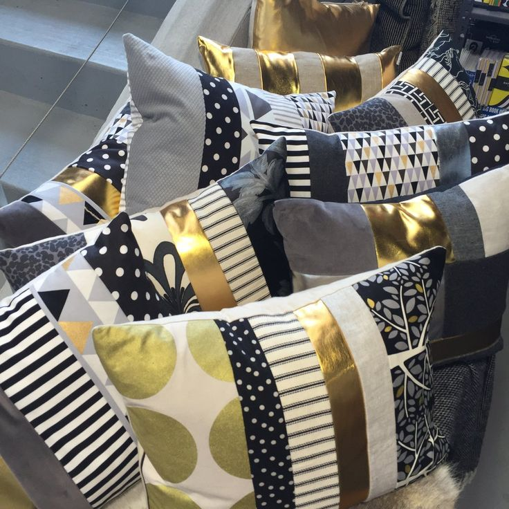 Gerty Brown for Collected exclusive range of hand crafted cushions featuring a super cool neutral palette, with contrasts in black and just the right amount of
