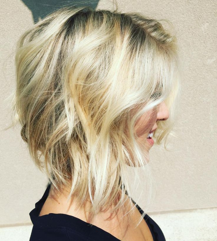 Bright baby blonde pairs perfectly with an undone choppy bob. Color by stylist Amber Lynn Maxwell. Aveda color formula in comments.