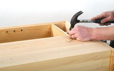 When it is all dry, fit the back, nailing it in place around the rebate and across the lower fixed shelf
