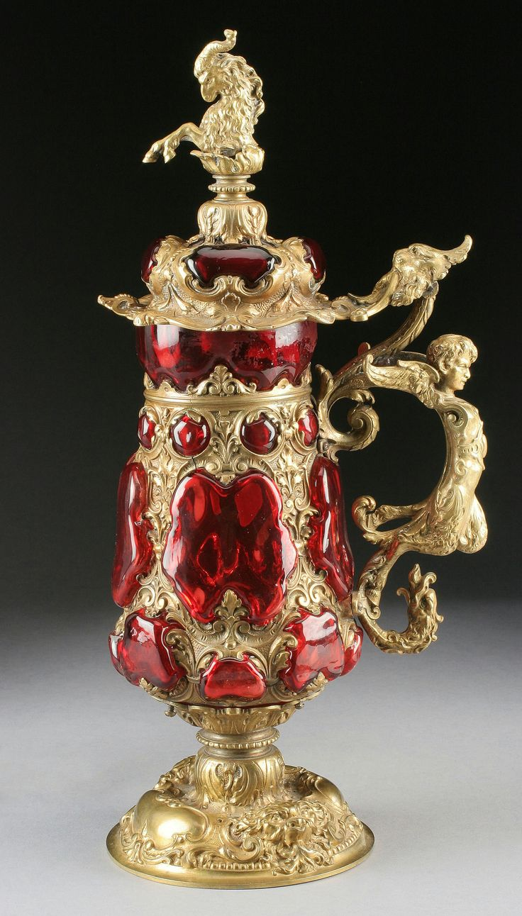 A GERMAN BAROQUE STYLE GILT METAL AND RUBY GLASS TANKARD 19th Century