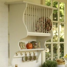 Picture this with some aqua plates, flowered tea cups and a cute teapot on shelve.... Very shabby chic