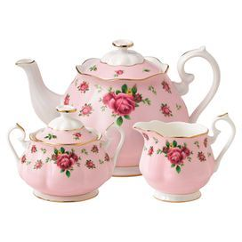 "3-piece bone china tea set. Includes a teapot, sugar bowl, and creamer with English rose motifs and gold trim.    Product: Teapot, covered sugar bowl and creamerConstruction Material: Bone chinaColor: PinkDimensions: 6"" H x 14.3"" W (teapot)"