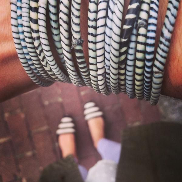 white flip flop bracelets swirled with tones of black and grey. hand-curated into a perfect set. made by hand from recycled flip flops. exact colors and patterns will always vary. fair trade & chic -- it's a doublehighfive!  click here for sizing