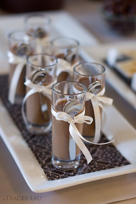 Chocolate mousse shots tied with a demitasse spoon.