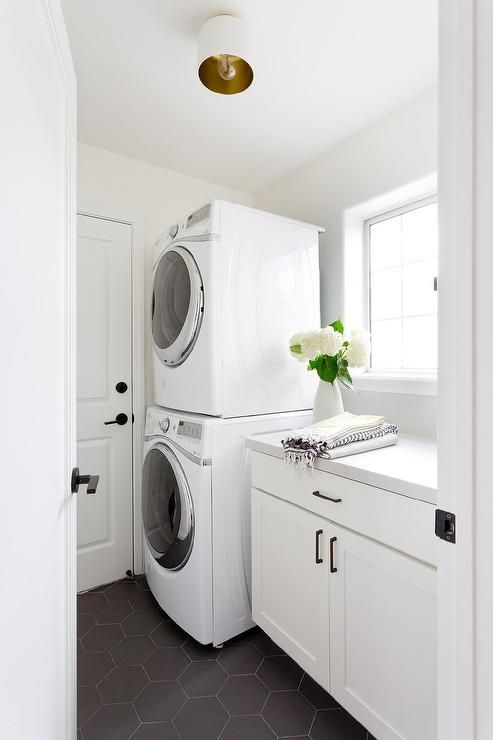Black And White Transitional Laundry Room Is Clad In Large