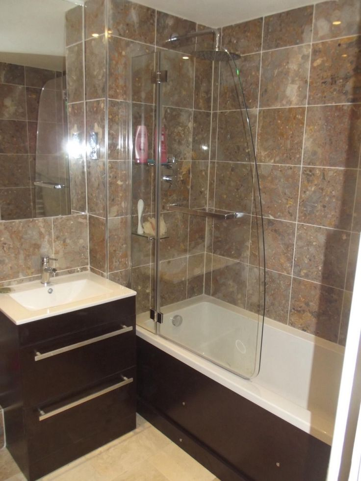 A very contemporary bathroom with marble wall and floor tiles.  http://www.ppmsltd.co.uk