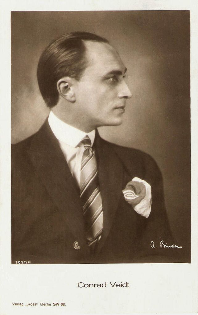 https://flic.kr/p/BDa5Ez | Conrad Veidt | German postcard by Ross Verlag, no. 1271/2, 1927-1928. Photo: A. Binder.  Conrad Veidt (1893–1943) was the most highly strung and romantically handsome of the German expressionist actors. From 1916 until his death, he appeared in well over 100 films, including such classics as Das Kabinett des Dr. Caligari/Das Cabinet des Dr. Caligari (Robert Wiene, 1920) and Casablanca (Michael Curtiz, 1942).   For more postcards, a bio and clips check out our blog…