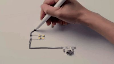 Silver conductive pen used to create origami city : Damnthatsinteresting