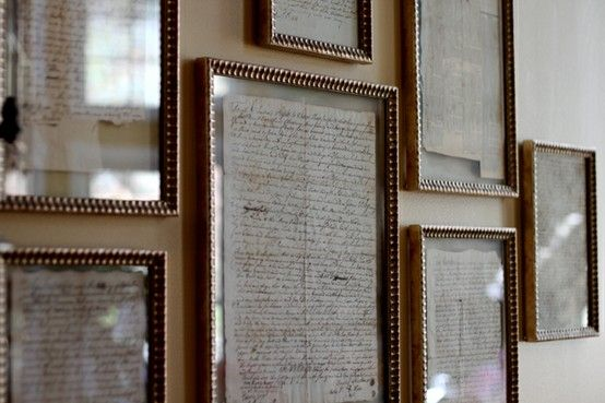 old letters in gold leaf frames..love the pieces between glass - no matting.  A great personal touch in a room.