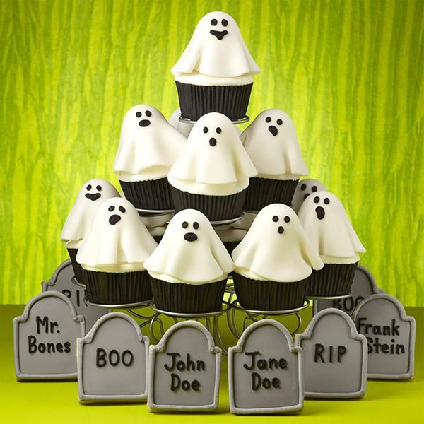 Ghosts in the Graveyard Cupcakes - What a hauntingly delicious scene! It's perfect for Halloween parties and get-togethers. Brownie pop ghosts baked with our Brownie Pops 8-Cavity Silicone Mold sit atop iced cupcakes.