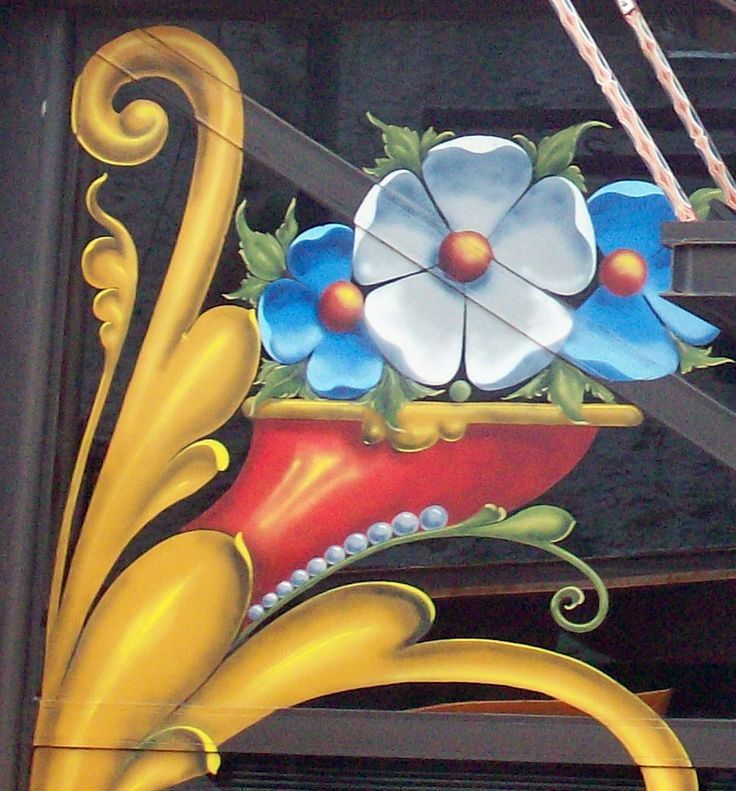 """""""Cornucopia"""" a segment of a painting decorating a store front in Buenos Aires"""
