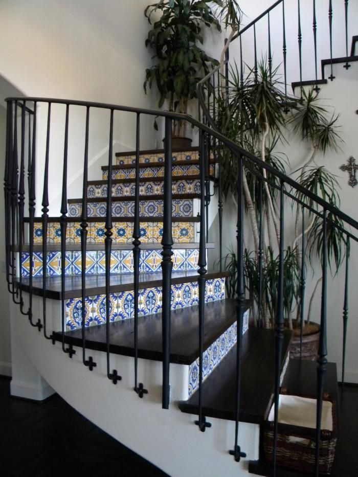 Blue and White Tiled Stair Risers-would like in Delft Blue, for stairs to basement, for color where there is none. From Remodelista.
