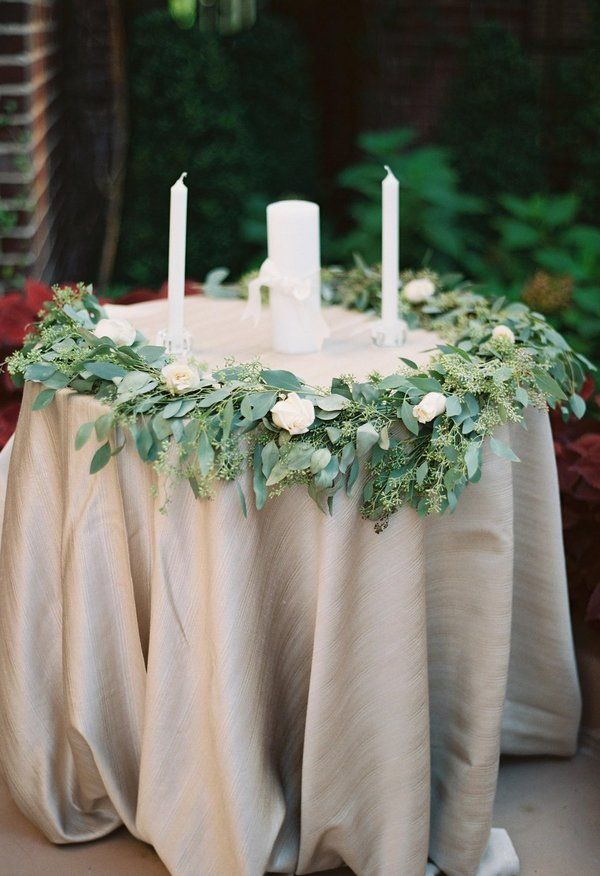 Seeded ecualyptus, garland wrapped around the unity candle table // Matoli Keely Photography