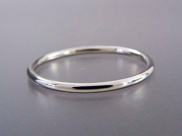 Thin Platinum Wedding Band - 1.3mm Wide Stacking Ring - Choice of hammered, matte or polished finish. $310.00, via Etsy.