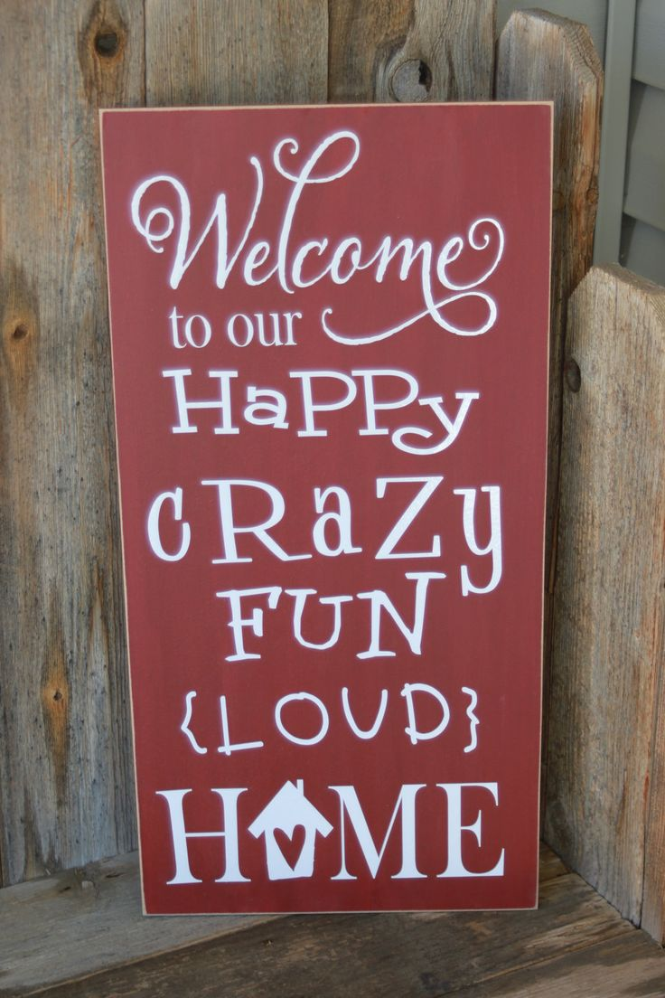 welcome to our happy crazy fun loud home - board with vinyl lettering. $24.00, via Etsy.