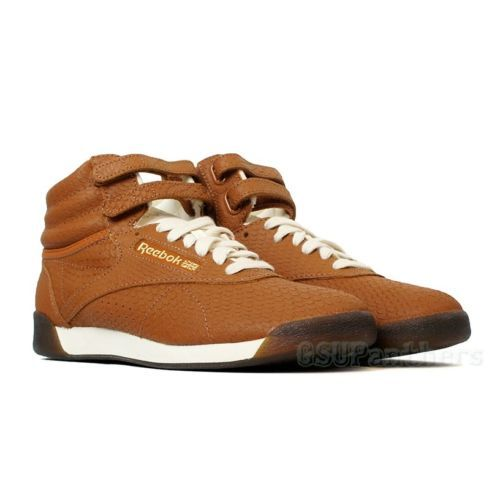 ad30b63088e Reebok Freestyle Hi Exotics (BROWN MALT CREAM CHALK GOLD) Women s Shoes  M44873