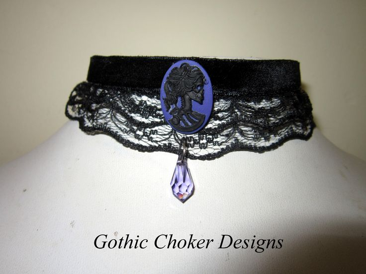 Gorgeous gothic choker!  Black velvet and ruffled layered lace choker with black skeleton on purple cameo and swarovsky crystal.  R140  Purchase here:  https://hellopretty.co.za/gothic-choker-designs/black-velvet-and-ruffled-layered-lace-choker-with-purple-skellie-cameo-and