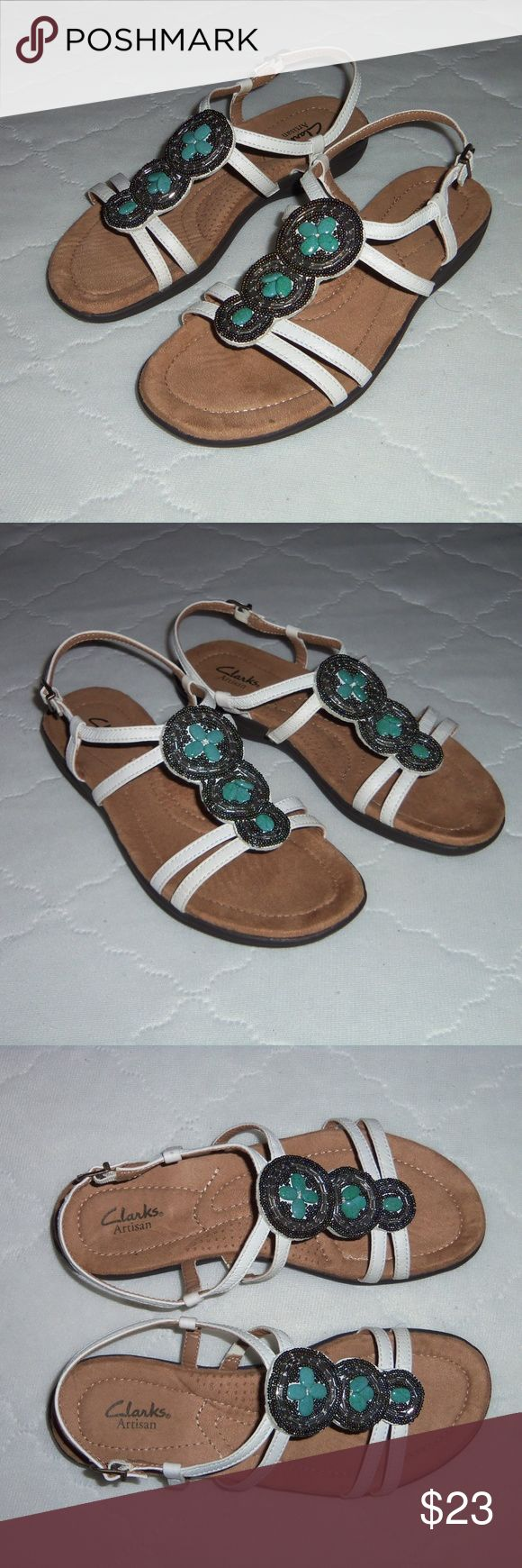 Clarks Artisan leather embellished sandals 7M Very nice pair of Clarks sandals embellished with turquoise looking stones with beading on top. Leather upper comfort foot bed, adjustable ankle straps. Excellent condition! View all pictures! Clarks Shoes Sandals