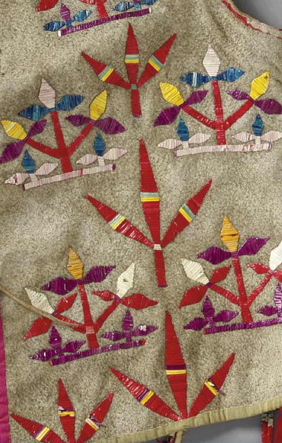 [DETAIL] A LAKOTA QUILLED HIDE VEST composed of hide, velvet, cotton cloth, porcupine quills, silk ribbon, tin cones, and dyed chicken feathers. Length with drops 21 in.